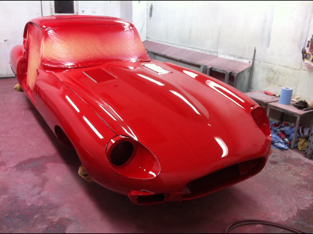 Red Jaguar E-Type in fresh paint.